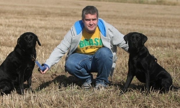 DOUGIE NICOLSON, COURIER, 25/09/11, NEWS. Pictured with his dogs Holly and Cuillan at his home near Letham today, Sunday 25th September 2011, is Cllr Donald Morrison. Story by Graham Brown, Forfar office.