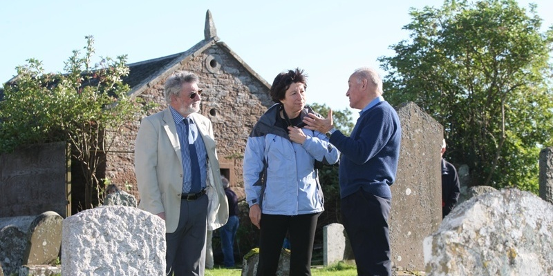 Steve MacDougall, Courier, Collace Mort House, Collace Churchyard, Collace. Restoration work starting on old mort house that was used to keep bodies safe from grave robbers. Pictured, left to right is and Councillor Alan Grant, Fiona Fisher (Heritage Trust) and Martin Payne (Burrelton & District Community Council). The mort house is in the background.