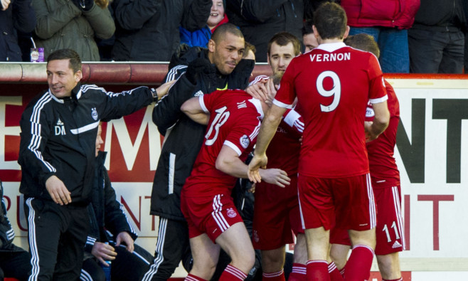 Aberdeen manager Derek McInnes (left) joins in the celebrations after Nicky Low's goal.