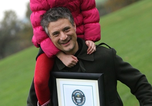 Kris Miller, Courier, 25/10/11. Picture today at Madalen Green shows Dominic and Lola Venditotzz being presented with the Guinness World Record for the largest piggyback race. The pair won the race which was held in the summer.