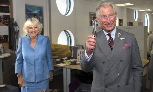 The Prince of Wales tried out a sonic screwdriver when he and the Duchess of Cornwall visited the set of Doctor Who.