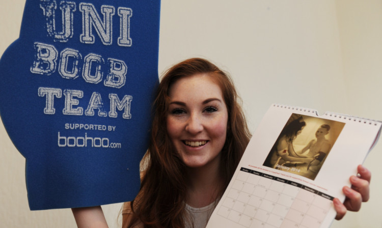 Emily Lucas with some of the Dundee Uni Boob Teams promotional material.