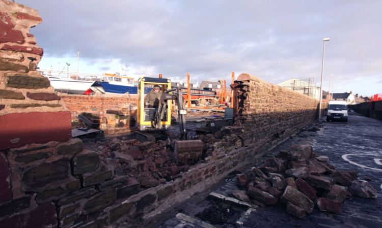 Damage to a wall at Arbroath Harbour.