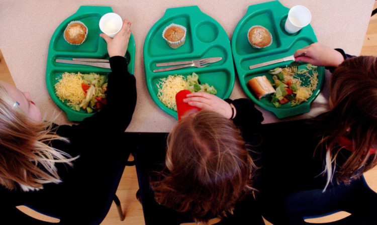 PARENTAL PERMISSION OBTAINED. Generic picture of pupils enjoying school dinners at a Primary School in Cambridgeshire.