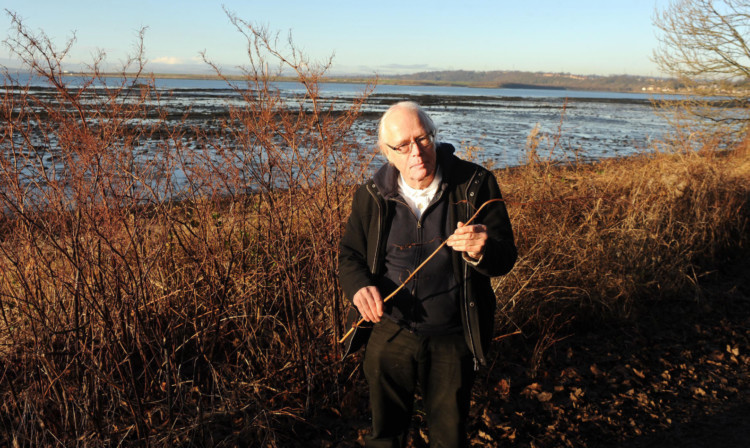 Dr John Emery-Barker with the Japanese Knotweed.