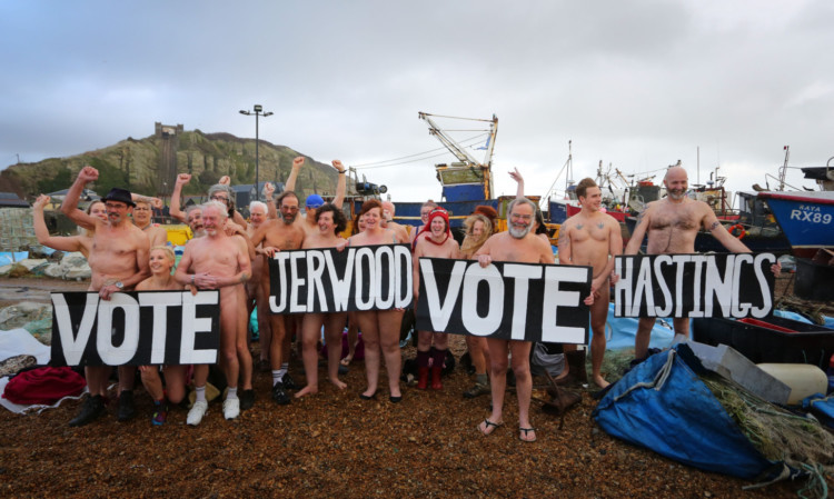 Residents in Hastings, bare all in a naked flash mob on the beach, as the Jerwood Gallery in the town competes to win a photographic portrait session with photographer Spencer Tunick.
