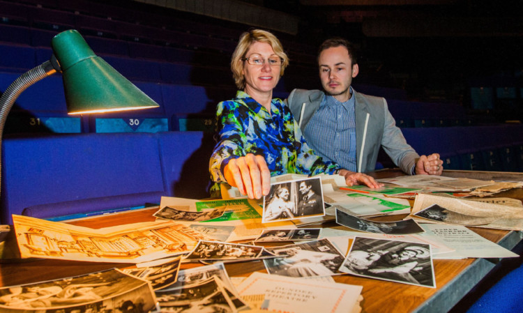 Alison McDicken and Graham King look at archive material.