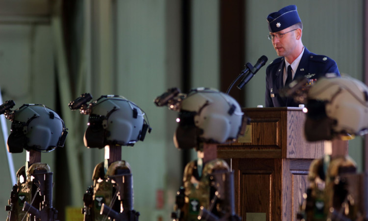 Lt Col Jared Herbert addresses a memorial service for killed USAF crew.