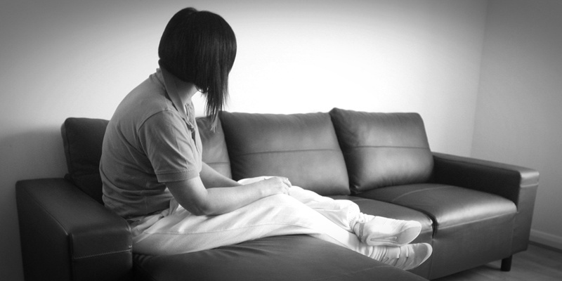 An unidentified abuse victim sits in a new refuge for women and children affected by domestic abuse in Glasgow.