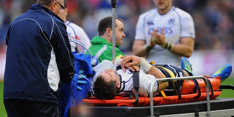 Scotland's Rory Lamont is taken off on a stretcher