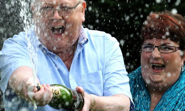 Colin and Chris Weir, from Largs in Ayrshire, celebrate during a photo call at the Macdonald Inchyra Hotel & Spa in Falkirk, after they scooped £161 million in Tuesday's EuroMillions draw.