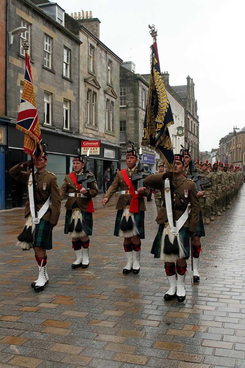 John Stevenson. Courier. 19/04/12. Fife Kirkcaldy. Homecoming parade by The Black Watch throught the streets of Kirkcaldy. Pic shows the troops as they march down the High Street.
