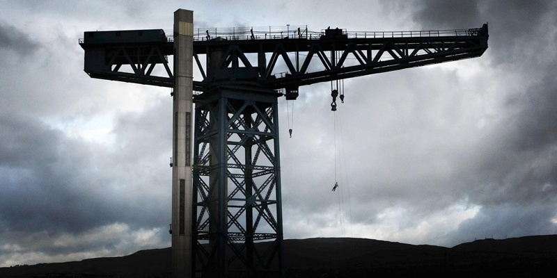 A fundraiser takes part in a sponsored 150-foot abseil off the Titan Crane, near Glasgow, to raise money for Deafblind Scotland and St Margaret's Hospice.