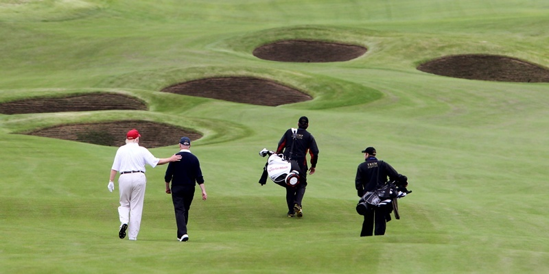 Donald Trump pats Sandy Jones, chief executive of the PGA