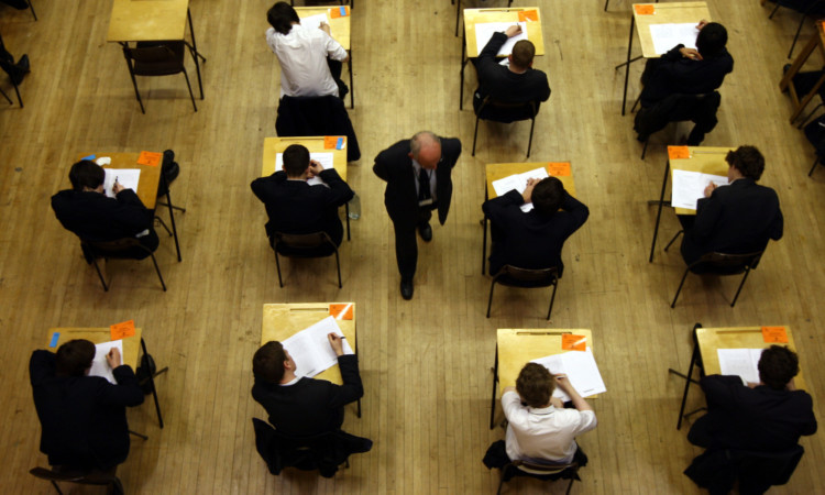 Pupils sit an exam at Lawrence Sheriff school Rugby.  PRESS ASSOCIATION Photo. Wednesday 7th March 2012. Picture credit David Jones/PA