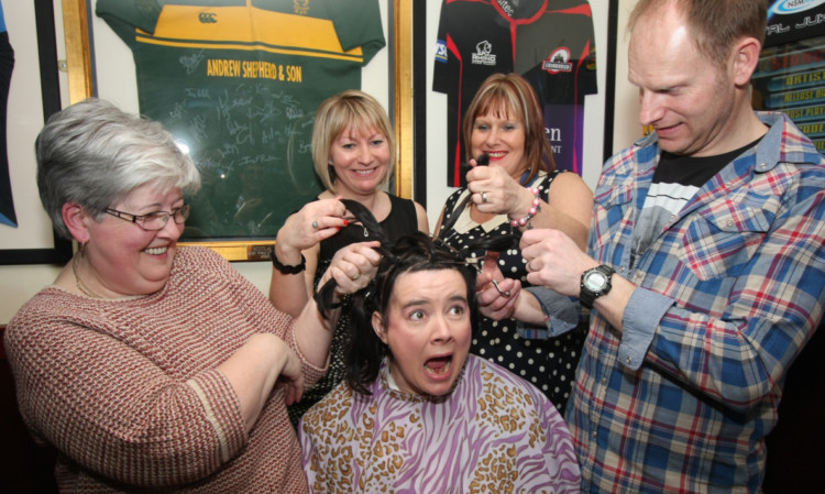 Gillian about to have her head shaved at the Millgate Bar to raise money for SAMH.