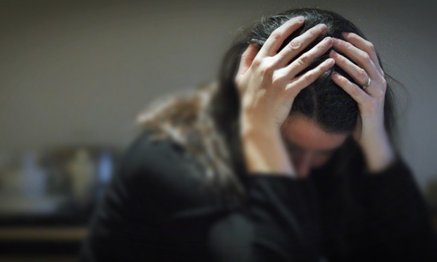 PICTURE POSED BY MODEL. File photo dated 08/11/07 of a woman with her head in her hands as severe depression can shrink the brain by blocking the formation of new nerve connections, a study has shown.