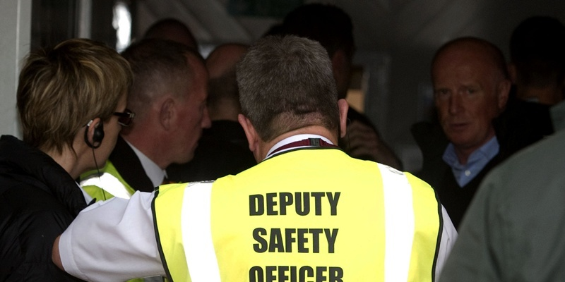 06/10/12 CLYDESDALE BANK PREMIER LEAGUE MOTHERWELL v DUNDEE UTD FIR PARK - MOTHERWELL A safety officer conducts talks in the tunnel after a power cut prevents the match from taking place