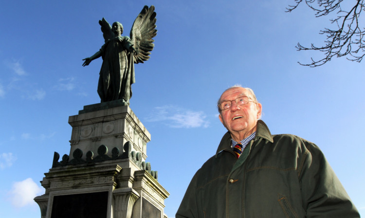 Dave Carstairs beside the war memorial in Cupar, which is to be restored thanks to a grant.