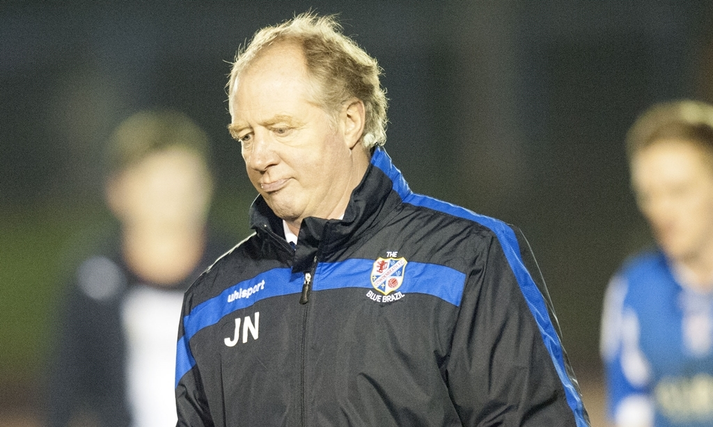 18/01/14 SCOTTISH CHAMPIONSHIP COWDENBEATH V FALKIRK (0-2) CENTRAL PARK - COWDENBEATH Cowdenbeath manager Jimmy Nicholl heads for the dressing room after watching his defeated by Falkirk.