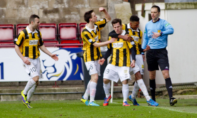 Liam Buchanan (centre) celebrates after netting East Fifes equaliser from the penalty spot.