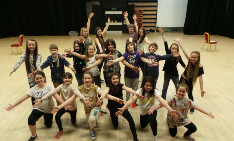 Young performers from Thomson-Leng Youth Musical Theatre at the Bonar Hall rehearsing for their debut in Broadway! a Musical Celebration.
