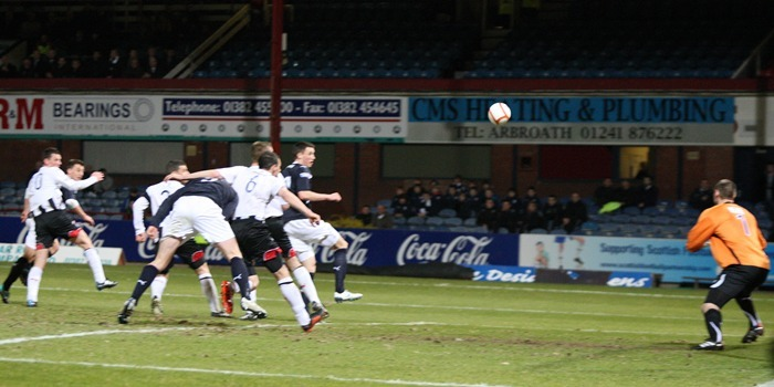 Kris Miller, Courier, News, 22/03/11. PIcture at Dens Park.  Dundee V Dunfermline.  Dundee trialist Jake Hyde's header beats Chris Smith.