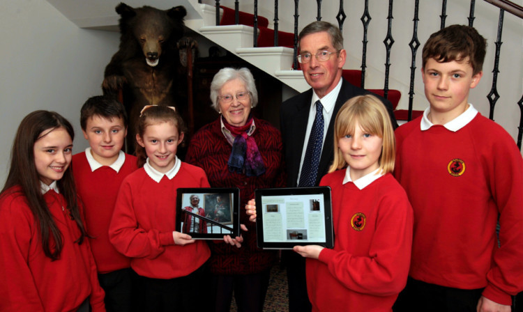 From left: Ciara McIntosh, Shaun Gordon, Alanah Rumcie, Mrs Christy Bing, Viscount Keith Arbuthnott, Cait McKay and Luke Woodley with the new digital guide.