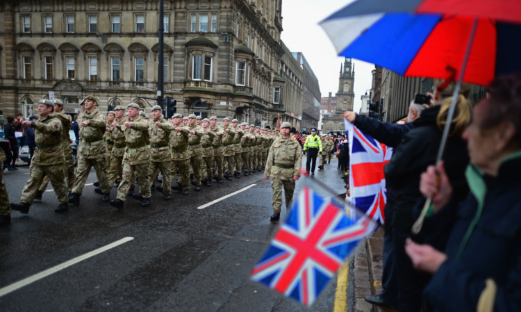 Around 200 soldiers from The Royal Scots Dragoon Guards take part in a homecoming parade in Glasgow.
