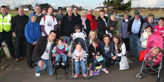Steve MacDougall, Courier, Easthaven Carpark. Easthaven to Arbroath YOMP. Pictured, those that attended the Easthaven Start. At the front is Carnoustie family Fraser Hirsch, wife Aevril (check spelling) and daughters inlcuding Ayley and Chloe. Also pictured are family and friends of the Hirsch's alongside other walkers.