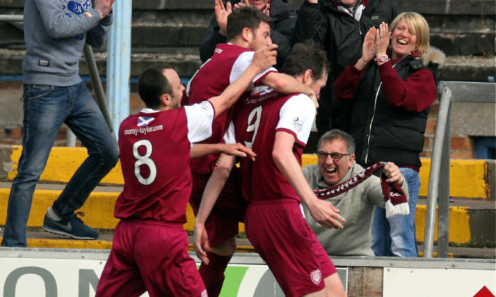 Team-mates help Kenny Deuchar, right, celebrate his goal.