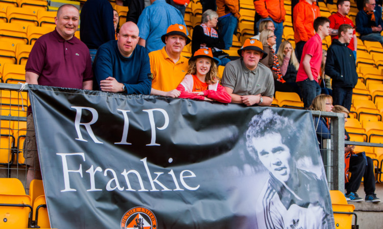 The Frank Kopel Travelling Shindig and Display Boys flew a banner in memory of the Tannadice legend at McDiarmid Park on Saturday. Pictured with the tribute, from left, are Scott Innes, Jimmy McDonald, Jonny Kettles, Emily Kettles and Dane Vannet.