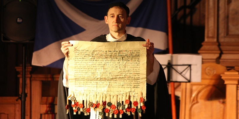 Steve MacDougall, Courier, St Andrews Church, Arbroath. Tartan Day, Signing of the Declaration. Pictured, Ken Lownie (Abbot Pernard) with the Declaration. Check spellings.