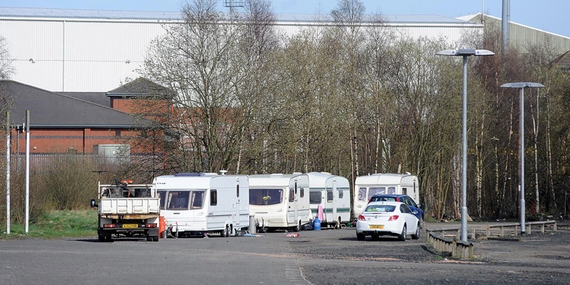 Travellers in the carpark at Lee's Park Road in the shadow of East End Park