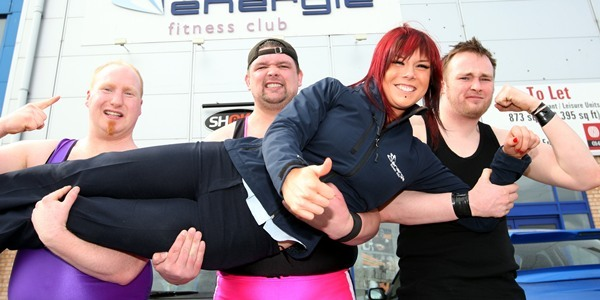 Steve MacDougall, Courier, Energie Fitness, Douglas, Dundee. Wrestlers visit the gym and get guidance from experts. Pictured, at the front is Fitness Instructor Kirsten Watson, being held aloft by (left to right), 'Mr News' Alan Smith, 'Bravehart' David Low (correct spelling of Bravehart) and 'All Night' Ian Ambrose.