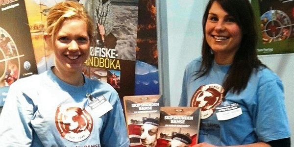 Graham Brown 13/4 Bamse Book.  Supplied pic. Story Forfar office.  Pic shows Tun Forlag sales representatives Hilde and Vilde, in Bamse T-shirts, with the new book at an Oslo Book Fair. ends