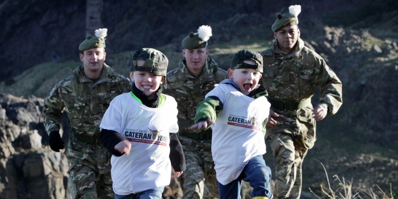 Soldiers from 2nd Scots RHF join kids from Elsie Inglis Nursery at Holyrood Park in Edinburgh to launch the Alliance Trust Cateran Yomp which is Scotland's new big annual walk across 54 miles of Perthshire on 25th and 26th of June.Ryan McCafferty (4) and Cole Hamilton (4, front) with Dominic Milligan, David Walker and Kennard Wade.More info from Danny Parker, Stripe Communications on 0131 561 8628.Pic by Ashley Coombes/Epicscotland. 10/2/11