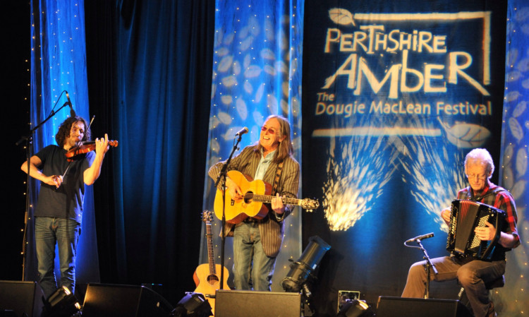 Dougie MacLean performing at a previous Perthshire Amber.