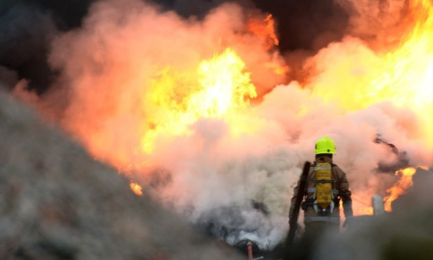 Firefighters battled a large blaze between Douglas and Whitfield on May 19 after tyres were set alight. Emergency services rushed to Piper Street, near Whitfield, and appliances from the Kingsway fire station used water jets for over two hours before the inferno was contained.