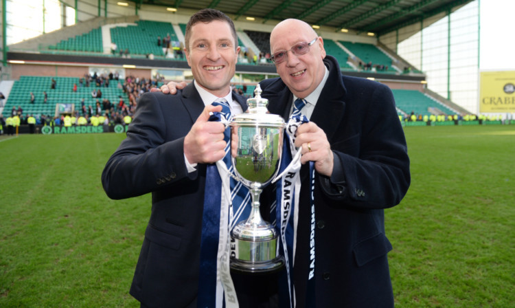 Turnbull Hutton celebrates Ramsdens Cup success with boss Grant Murray.