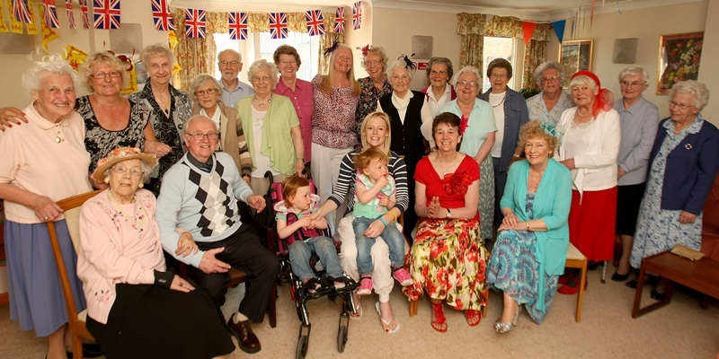 Kim Cessford, Courier, - 29.04.11 - the Carnoustie twins dropped in on the residents of Hometay House, Monifieth where the royal weddingt was being enjoyed on a big screen lent by Hosies - a collection had been made towards the cahrity fund for the twins - pictured centre l to r - Chloe, Ayley and mum Averil - with residents - words from Craig