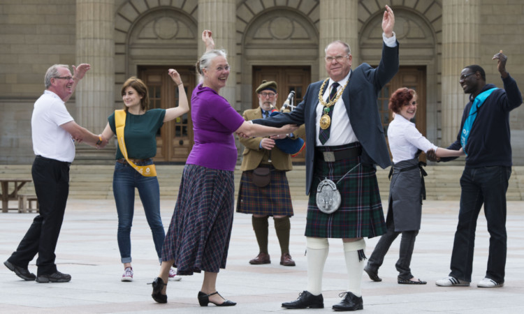 Royal Scottish Country Dance Society caller and teacher Pia Walker dances with Lord Provost Bob Duncan.