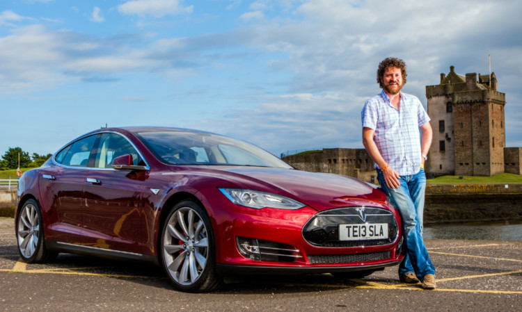 Chris van der Kuyl arrives back in Dundee with his new Tesla.