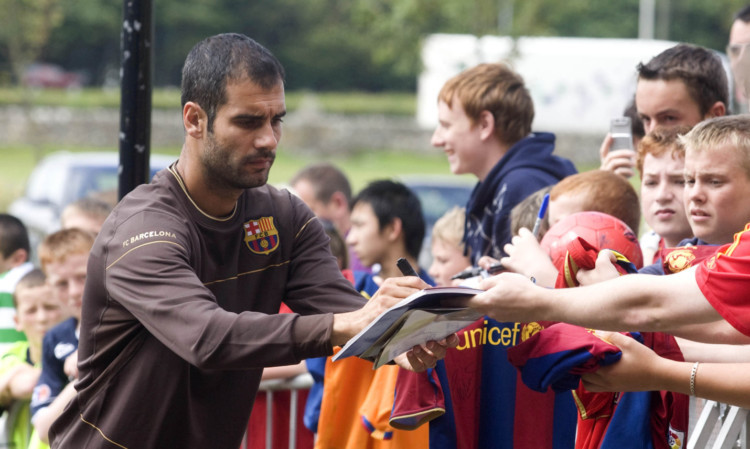 Then Barca boss Pep Guardiola signs autographs at St Andrews in 2008.