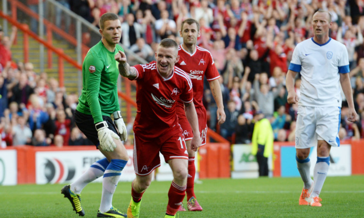 Jonny Hayes celebrates making it 4-0.