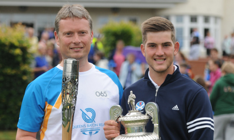 Baton bearer and former Amateur golf champion Stuart Wilson meets new champion Bradley Neil at Blairgowrie Golf Club.