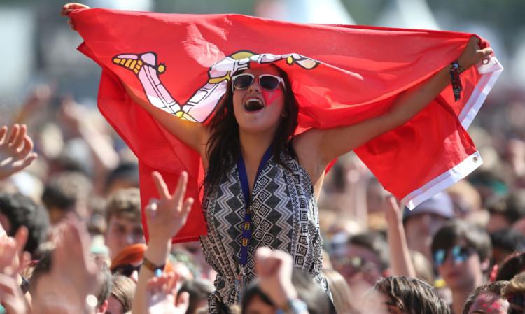 Fun in the sun: music fans enjoying the entertainment.