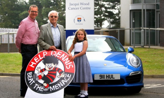 Gordon and Lucy Robertson with Aubrey Wood, centre, vice-chairman of the Ninewells Cancer Campaign, who accepted the donation of almost £17,500.