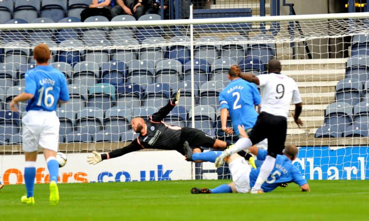 St Johnstone goalkeeper Alan Mannus is beaten by a Christian Nade strike.