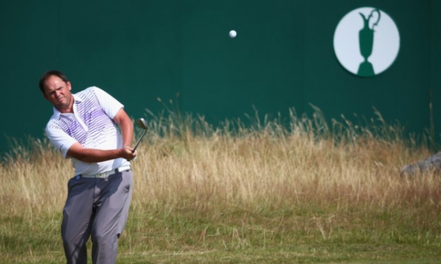Jamie McLeary hits a pitch shot to the 18th green.